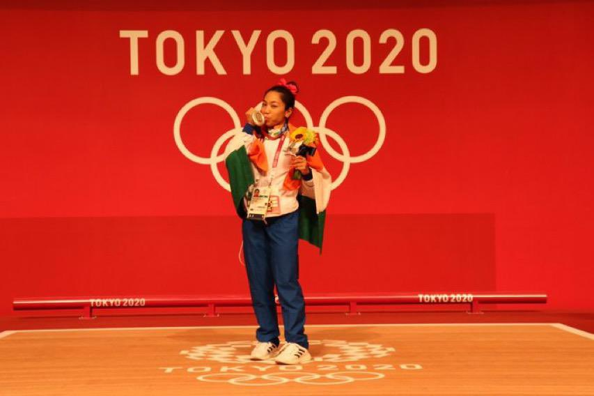 Mirabai Chanu: She travelled 20 km each day to her training centre in Manipur! - Mirabai Chanu is a weightlifter from Manipur state of India, a Padma Shri who created history after winning India's first medal of the Tokyo Olympics when she clinched silver in women's 49kg weightlifting event on Saturday. Here are some unknown facts regarding her family, her struggle, her parents struggle which helped her to emerge stronger in the run to Olympics: